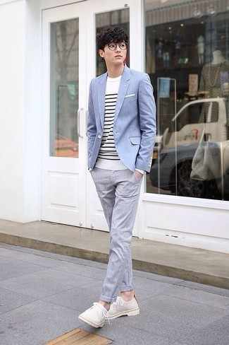 Light Blue Blazer Outfits For Men: A light blue blazer and grey chinos will add sophisticated style to your current routine. For something more on the classier end to complement your look, complement this outfit with a pair of beige suede derby shoes.