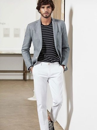 Black and White Canvas Low Top Sneakers Outfits For Men: For an outfit that's absolutely wow-worthy, reach for a grey blazer and white chinos. Black and white canvas low top sneakers will add a dressed-down touch to an otherwise standard look.