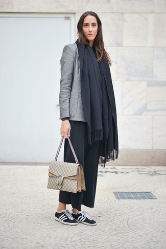 A grey blazer and black culottes feel perfectly suited for weekend activities of all kinds. Opt for a pair of black and white low top sneakers for a more relaxed aesthetic. If you're already bored of your fall fashion options, this getup just might be the inspiration you need.