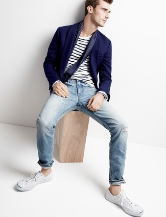 How to wear: navy blazer, white and navy horizontal striped long sleeve t-shirt, light blue jeans, white canvas low top sneakers