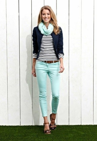 Black Long Sleeve T-shirt Outfits For Women: A black long sleeve t-shirt and mint skinny jeans matched together are a total eye candy for ladies who prefer relaxed styles. For a more elegant twist, complement this ensemble with brown leather heeled sandals.