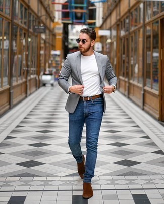 Blue Skinny Jeans Outfits For Men: This combination of a grey blazer and blue skinny jeans is hard proof that a safe casual look doesn't have to be boring. Brown suede chelsea boots will bring an added touch of style to an otherwise all-too-common ensemble.
