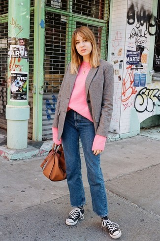How to wear: brown wool blazer, hot pink oversized sweater, blue jeans, black and white canvas high top sneakers