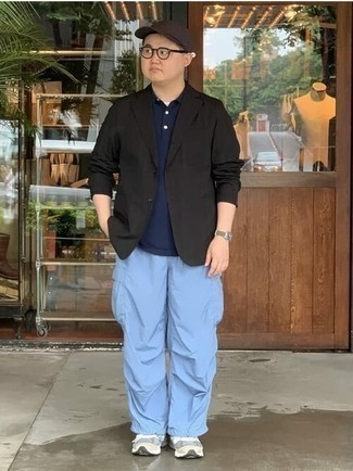 Jacket Outfits For Men: Show that you do casual like no-one else by wearing a jacket and light blue cargo pants. Add grey athletic shoes to your getup to keep the look fresh.