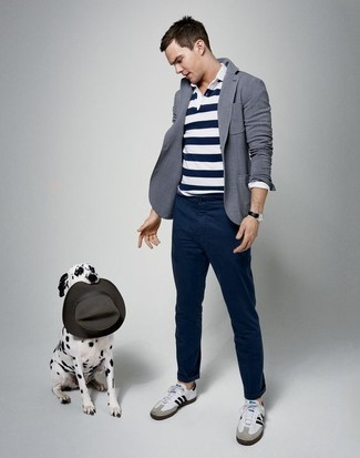 Nicholas Hoult wearing Grey Blazer, White and Navy Horizontal Striped Polo, Navy Chinos, White Leather Low Top Sneakers