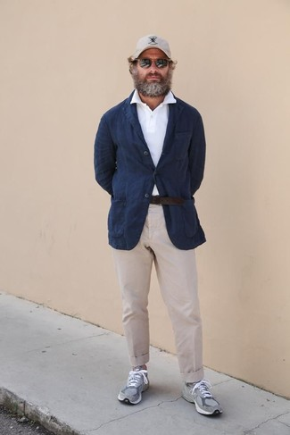 How to Wear a Belt After 40 For Men: Pairing a navy linen blazer with a belt is an awesome pick for a cool and casual getup. A pair of grey athletic shoes looks great here.