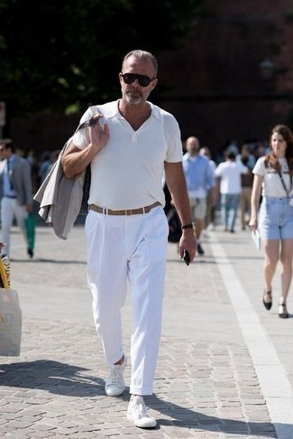 Blazer Outfits For Men: For an effortlessly smart menswear style, try pairing a blazer with white chinos — these pieces go beautifully together. Take your look a more informal path by slipping into white canvas low top sneakers.