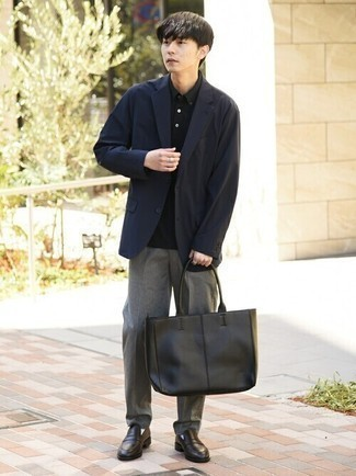 Black Polo Outfits For Men: Combining a black polo with grey chinos is an awesome pick for a laid-back but sharp outfit. Why not introduce dark brown leather loafers to this outfit for an added touch of style?