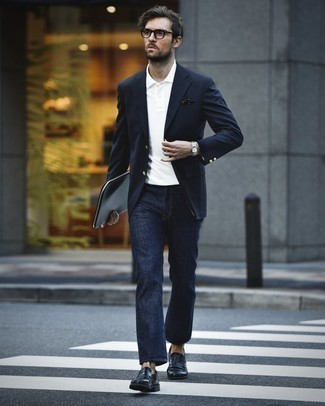 How to Wear a Blazer For Men: We're loving how this smart pairing of a blazer and navy jeans instantly makes any man look stylish. A good pair of black leather loafers is an easy way to inject an extra touch of refinement into this outfit.