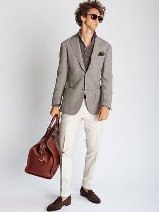 How to Wear a Brown Leather Holdall For Men: A grey blazer and a brown leather holdall work together smoothly. Channel your inner Idris Elba and class up your look with dark brown suede loafers.
