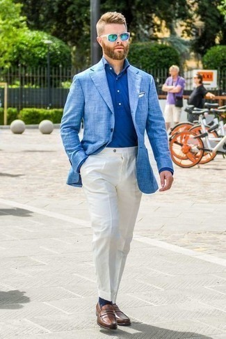 Light Blue Blazer Outfits For Men: This is definitive proof that a light blue blazer and white dress pants look amazing when paired together in an elegant outfit for a modern gent. Complement this outfit with a pair of brown leather loafers and you're all done and looking spectacular.