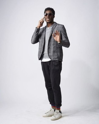Blazer Outfits For Men: Consider wearing a blazer and black chinos to assemble an interesting and modern-looking ensemble. Add a pair of white and green leather low top sneakers to the equation to easily kick up the fashion factor of this ensemble.