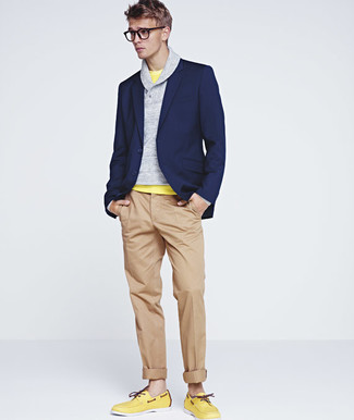 Stand out among other stylish civilians in a navy blazer jacket and camel  chinos. If