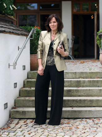 Gold Blazer Outfits For Women: A gold blazer and black wide leg pants are the kind of a tested combo that you need when you have no time to dress up. A pair of gold leather heeled sandals is a good idea to complement your getup.