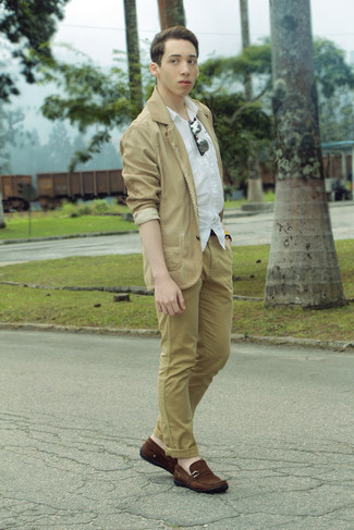 Stand out among other stylish civilians in a camel cotton blazer and tan  chinos. For