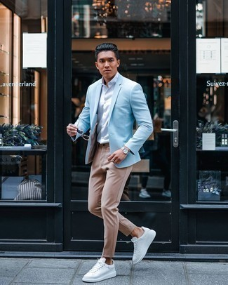 Khaki Chinos Outfits: For a casually sleek look, go for a light blue blazer and khaki chinos — these two pieces work really well together. Add a little kick to the outfit with white leather low top sneakers.