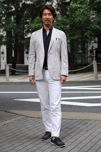 Grey Vertical Striped Blazer Outfits For Men: For classic style with a twist, pair a grey vertical striped blazer with white dress pants. Hesitant about how to finish? Introduce a pair of black leather boat shoes to the mix to change things up a bit.