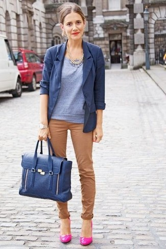 A blue blazer jacket and brown casual pants is a good pairing worth integrating into your wardrobe. Rocking a pair of hot pink leather pumps is a simple way to add extra flair to your outfit. Keep this combination in your head come spring, and we promise you'll save time brainstorming for a look on more than one morning.