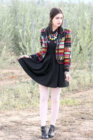 A multi colored graphic blazer jacket and a black skater dress are perfect for both running errands and a night out. Take a classic approach with the footwear and grab a pair of black leather booties.