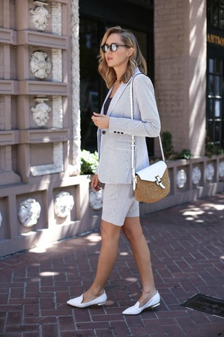 White Vertical Striped Blazer Outfits For Women: Go for a white vertical striped blazer and a white vertical striped bermuda shorts to achieve new heights in your personal style. To give your outfit a more sophisticated touch, add white leather loafers to the mix.