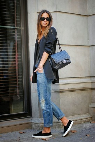 A black jacket and blue distressed boyfriend jeans will give off this very sexy and chic vibe. This outfit is complemented perfectly with black slip-on sneakers.
