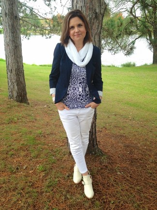 How to wear: navy blazer, navy and white print sleeveless top, white jeans, beige leather ankle boots