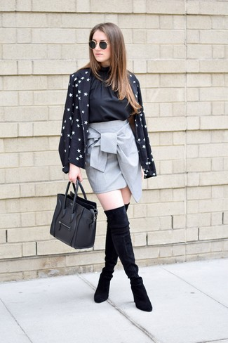 Consider wearing a black and white blazer jacket and a grey mini skirt for an effortless kind of elegance. Take a classic approach with the footwear and choose a pair of black suede over the knee boots.