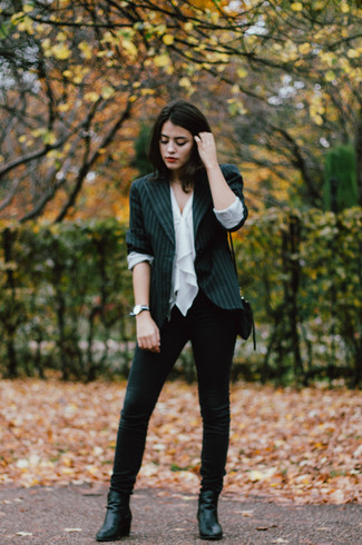Choose a black vertical striped blazer and black skinny jeans for both chic and easy-to-wear look. Add black leather ankle boots to your look for an instant style upgrade.