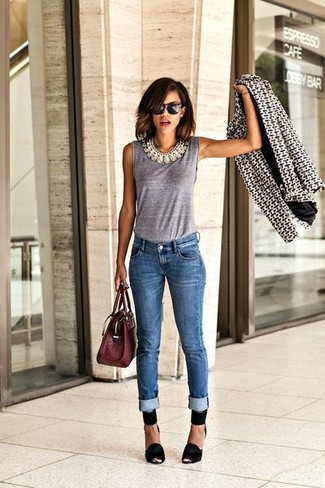 How to wear: black and white geometric blazer, grey sleeveless top, blue skinny jeans, black suede pumps