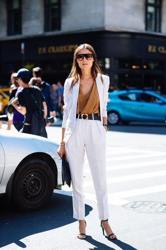 Marry a white linen blazer with a black embellished belt to bring out the stylish in you. Add black leather heeled sandals to your look for an instant style upgrade. So if it's a warm day and you want to look on-trend without exerting much effort, this ensemble will do the job in next to no time.