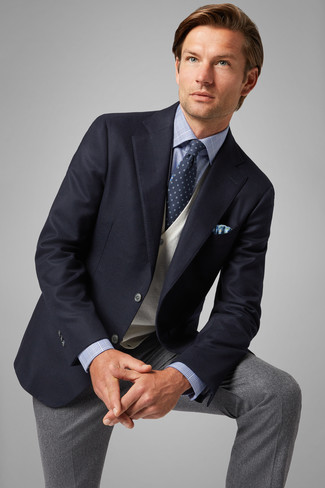 How to Wear Grey Wool Dress Pants For Men: You're looking at the definitive proof that a navy blazer and grey wool dress pants look awesome when married together in a refined outfit for a modern guy.