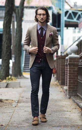 How to Wear a Black Leather Watch In Your 20s For Men: Reaching for something as basic as this laid-back combination of a tan blazer and a black leather watch can potentially set you apart from the crowd. Add a different twist to your outfit by sporting a pair of tan suede double monks.