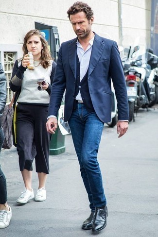How To Wear Blue Jeans With Black Leather Boots For Men: This combo of a navy blazer and blue jeans looks considered and immediately makes any gent look sharp. Look at how well this look is finished off with black leather boots.