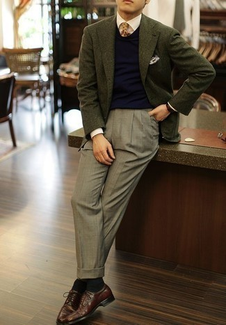 How to Wear a Dark Green Blazer For Men: This classy combo of a dark green blazer and grey dress pants is a popular choice among the dapper gents. If not sure as to what to wear in the footwear department, go with burgundy leather derby shoes.