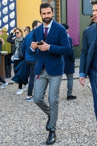 Violet Tie Outfits For Men: A blue wool blazer and a violet tie are absolute must-haves if you're picking out a sharp wardrobe that holds to the highest menswear standards. Add a playful vibe to this getup by slipping into a pair of black leather casual boots.