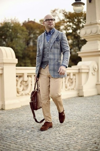 How to Wear a Grey Sweater Vest For Men: For a look that's elegant and GQ-worthy, rock a grey sweater vest with khaki dress pants. For a more relaxed twist, complement your ensemble with a pair of brown suede double monks.