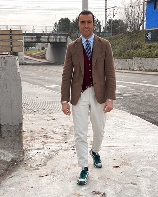 Brown Leather Belt Outfits For Men: A brown houndstooth wool blazer and a brown leather belt worn together are a match made in heaven. A pair of white and green athletic shoes looks perfect completing your look.