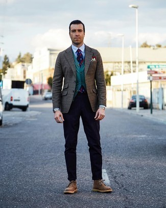 Watch Outfits For Men: You'll be surprised at how easy it is for any guy to put together a laid-back outfit like this. Just a brown plaid blazer and a watch. Complement your ensemble with brown suede desert boots to take things up a notch.