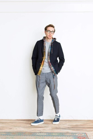 Grey Sweatshirt Outfits For Men: Go for a grey sweatshirt and grey dress pants to look smooth and classic. A pair of blue suede low top sneakers introduces just the right amount of visual interest to this ensemble.