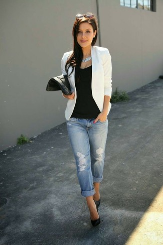 Step up your off-duty look in a white blazer and baby blue distressed boyfriend jeans. Black leather pumps will add a touch of polish to an otherwise low-key look.