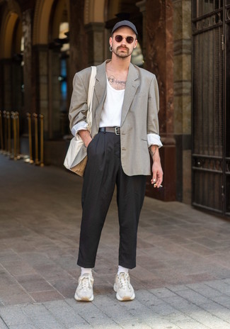 Black Chinos Outfits: A beige check blazer and black chinos combined together are the ideal outfit for gents who love classic and casual styles. If you want to effortlessly dress down your outfit with one item, why not add a pair of beige athletic shoes to the mix?