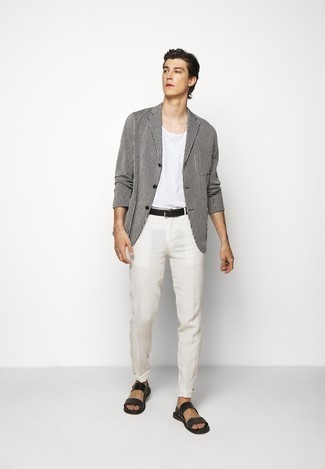 Black Leather Sandals Outfits For Men: This pairing of a white and black vertical striped blazer and white linen chinos is undoubtedly a statement-maker. And if you need to instantly tone down your look with one item, complete this outfit with black leather sandals.