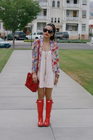 Dress in a multi colored floral jacket and a white lace tank dress for a Sunday lunch with friends. Why not add red rain boots to the mix for a more relaxed feel?