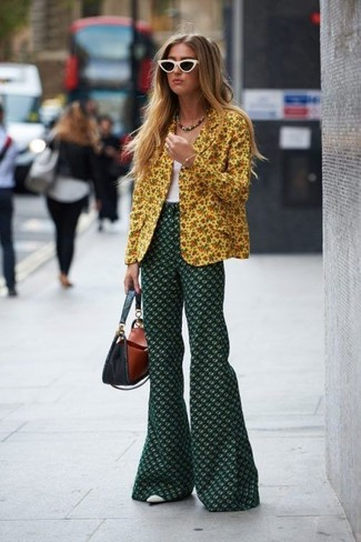 How to wear: yellow floral blazer, white tank, dark green floral flare pants, white leather pumps