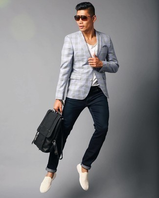 Black Leather Backpack Summer Outfits For Men: We all want functionality when it comes to styling, and this casual combo of a light blue plaid blazer and a black leather backpack is a great example of that. Beige canvas slip-on sneakers will easily elevate even your most comfortable clothes. Needless to say, it's easier to work through a warm afternoon in a light and breezy ensemble like this.