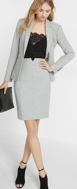 A nicely put together combination of a grey blazer jacket and a silver pencil skirt will set you apart effortlessly. A pair of black cutout suede ankle boots looks proper here. There's no nicer way to cheer up a gloomy autumn afternoon than a cool ensemble like this one. (Ok, maybe there are a couple.)