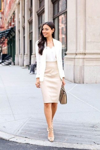 White Blazer Outfits For Women: This combination of a white blazer and a beige leather pencil skirt is classy, but in a really cool way. Our favorite of an endless number of ways to complement this ensemble is a pair of beige leather heeled sandals.