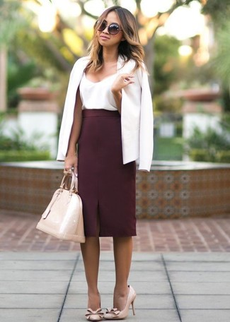 White Blazer Outfits For Women: Marry a white blazer with a burgundy pencil skirt for a sleek polished getup. Let your expert styling really shine by rounding off your ensemble with beige leather pumps.