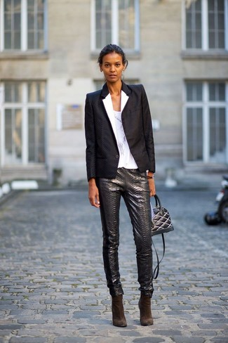 A monochrome blazer jacket and dark grey leather slim trousers are great staples that will integrate perfectly within your current looks. Finish off your look with dark brown suede ankle boots.