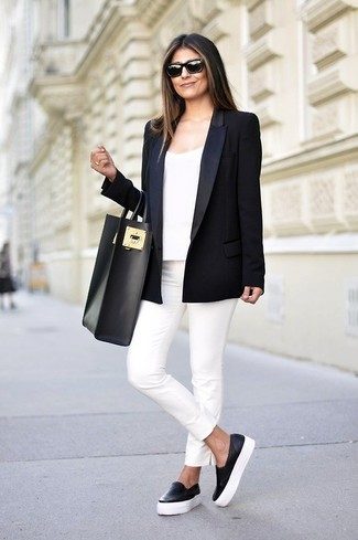 A black blazer jacket and white slim pants feel perfectly suited for weekend activities of all kinds. A pair of black leather slip-on sneakers brings the dressed-down touch to the ensemble.